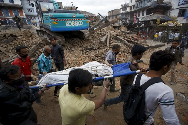 Rescue workers carry the body of a victim on a stretcher, after a 7.9 magnitude earthquake hit, in Kathmandu, Nepal April 25, 2015. (Photo by Navesh Chitrakar/Reuters)