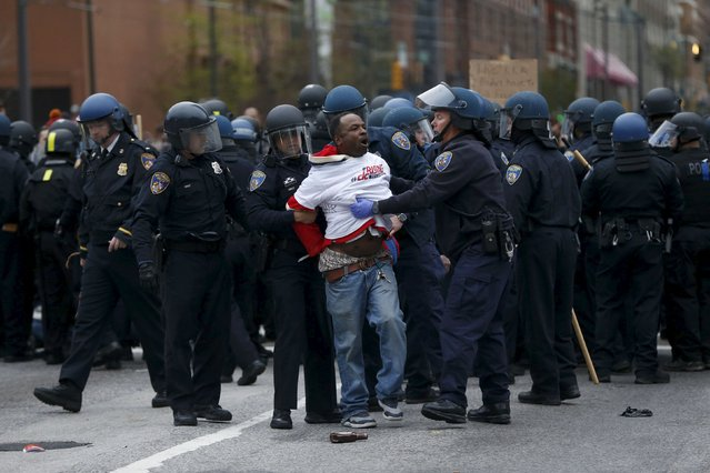Police detain a protester at a rally to protest the death of Freddie Gray who died following an arrest in Baltimore, Maryland April 25, 2015. (Photo by Shannon Stapleton/Reuters)