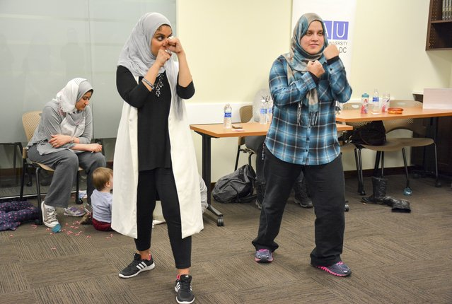 Egyptian-American community activist Rana Abdelhamid (L) demonstrates a move during a self-defense workshop designed for Muslim women in Washington, DC, March 4, 2016 in this handout photo provided by Rawan Elbaba. (Photo by Rawan Elbaba/Reuters)
