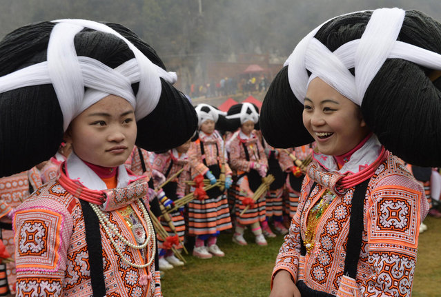 Ethnic Miao women with headwear are seen during their annual Tiaohua festival in Suoga village, Guizhou province on February 9, 2014. (Photo by Reuters/Stringer)