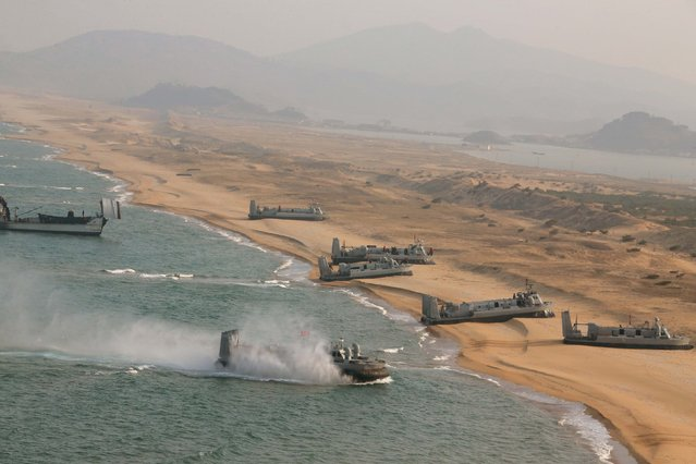 Landing and anti-landing exercises being carried out by the Korean People's Army (KPA) at an unknown location are seen in this undated photo released by North Korea's Korean Central News Agency (KCNA) in Pyongyang on March 20, 2016. (Photo by Reuters/KCNA)