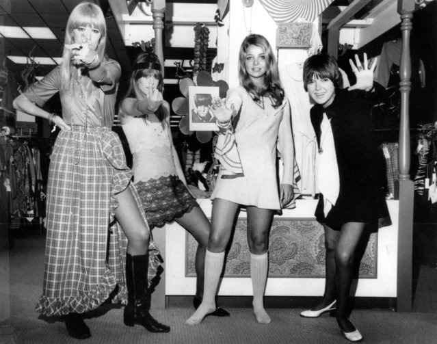 British fashion designer Mary Quant, right, waves as she poses with models wearing her Mod creations in Little Rock, Ark. on October 25, 1968. The models, from left, are, Amanda Tear, Rory Davis and Penny Yates. (Photo by AP Photo)