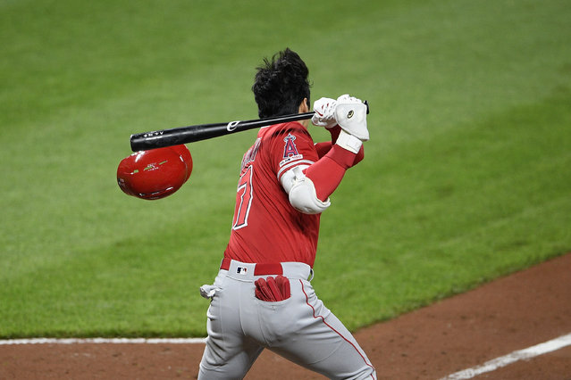 Los Angeles Angels' Shohei Ohtani, of Japan, loses his helmet as he grounds out during the sixth inning of a baseball game against the Baltimore Orioles, Friday, May 10, 2019, in Baltimore. (Photo by Nick Wass/AP Photo)