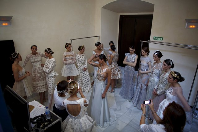 "Models wearing creations by Alejandro Postigo wait backstage during ""SIQ, Sevilla Handcraft and Fashion"" in the Andalusian capital of Seville, southern Spain May 14, 2015. (Photo by Marcelo del Pozo/Reuters)"