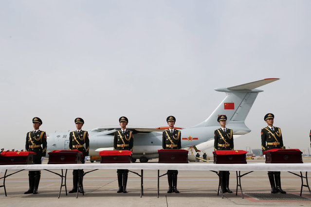 Members of a Chinese honor guard stand in front of boxes containing the remains of Chinese soldiers who were killed in the 1950-53 Korean War during a repatriation ceremony at Incheon Airport in Incheon, South Korea, 31 March 2016. The repatriation of the remains of 36 Chinese soldiers, who fought alongside North Korean forces in the 1950-53 Korean War against the South Korean army backed by the United States and other Western powers, is the third of its kind since South Korea and China agreed in 2014. (Photo by Jeon Heon-Kyun/EPA)