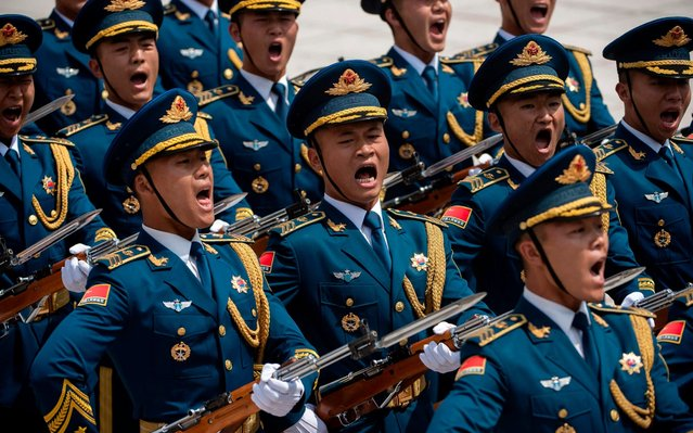 Chinese honour guards shout during a welcome ceremony for Greek President Prokopis Pavlopoulos (not pictured) at the Great Hall of the People in Beijing on May 14, 2019. (Photo by Nicolas Asfouri/AFP Pfoto/Pool)