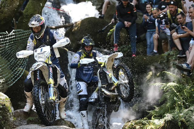 The World Enduro Super Series roared back into life this weekend with Mario Roman coming out on top at the Toyota Porto Extreme XL Lagares on May 12 to stake an early claim for the title of Ultimate Enduro Champion 2019. The Spaniard beat the 300 competitors, including 50 pros, who entered Sunday's Hard Enduro feature race in the baking Portuguese heat. Here: Graham Jarvis and Billy Bolt race at Toyota Porto Extreme XL Lagares, Portugal on May 12, 2019. (Photo by Future7Media/Red Bull Content Pool via AP Images)