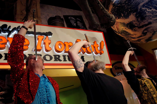 (L-R) Sword swallowers Fred Kahl, James Stilianos and Kyle Mertz swallow swords at Ripley's Believe It or Not! Times Square Odditorium to celebrate World Sword Swallower's Day in Manhattan, New York, U.S., February 25, 2017. (Photo by Andrew Kelly/Reuters)