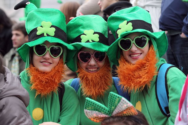 Spectators dressed as leprechauns attend St Patrick's Day parade in Dublin on March 17, 2014. (Photo by Peter Muhly/AFP Photo)