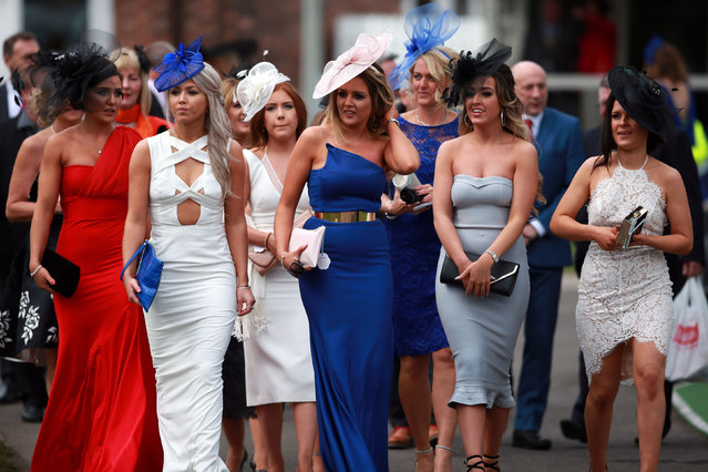 Arriving in force: racegoers attends Ladies Day of the Crabbie's Grand National Festival at Aintree Racecourse on April 8, 2015 in Liverpool, England. (Photo by David Davies/PA Wire)