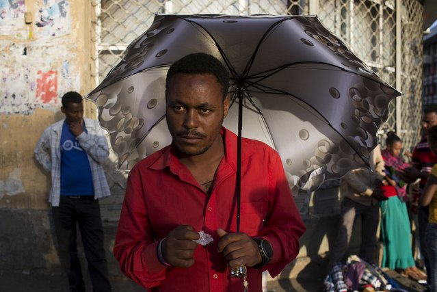 A man sells umbrellas on a street in Addis Ababa, Ethiopia, May 18, 2015. (Photo by Siegfried Modola/Reuters)
