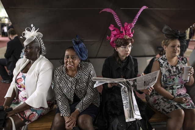 Four women take a break on the first day of races at Ascot Racecourse on June 18, 2019 in Ascot, England. The five-day meeting is one of the highlights of the horse racing calendar, with 2011 marking the 300th anniversary of the annual event. Horse racing has been held at the famous Berkshire course since 1711. (Photo by Dan Kitwood/Getty Images)