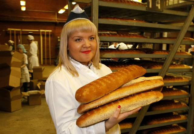 Julia Perminova, a dough specialist, who is also a model of the SibPlus Models agency and a participant of the Miss Doughnut 2016 beauty competition, works at a bakery in Krasnoyarsk, Siberia, Russia March 3, 2017. (Photo by Ilya Naymushin/Reuters)