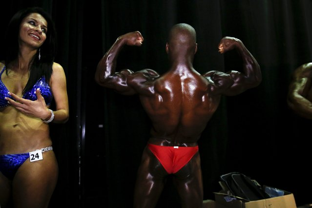 A bodybuilder strikes a pose backstage during an amateur competition in the Israeli city of Dimona, on April 3, 2014. (Photo by Finbarr O'Reilly/Reuters)
