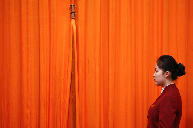 An attendant stands in the Great Hall of the People during the opening session of the Chinese People's Political Consultative Conference (CPPCC) in Beijing, China, March 3, 2017. (Photo by Thomas Peter/Reuters)