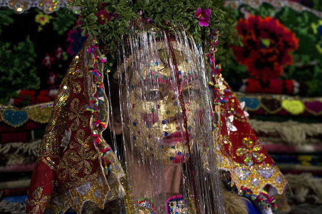 "Emilia Pechinkova, a 24-years-old Bulgarian Pomak (Bulgarian speaking Muslims) bride poses for a photograph following the ""gelina"" or face painting ceremony carried out by female guests and relatives in preparation for her three-day wedding ceremony in the village of Draginovo, 100 kms southeast of Sofia on April 22, 2016. Bulgaria's Muslim population is one of the highest in the European Union. (Photo by Nikolay Doychinov/AFP Photo)"