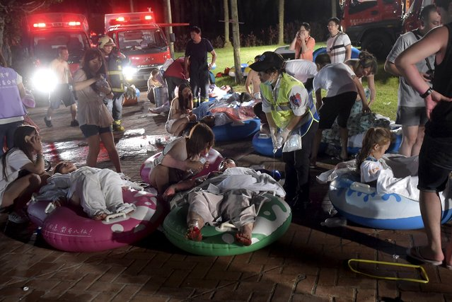 Injured victims from an accidental explosion during a music concert lie on the ground at the Formosa Water Park in New Taipei City, Taiwan, June 27, 2015. About 200 people were injured after a fire suspected to have stemmed from the explosion of an unknown flammable powder occurred in a recreational park in northern Taiwan, local media reported on Saturday. (Photo by Wang Wei/Reuters)