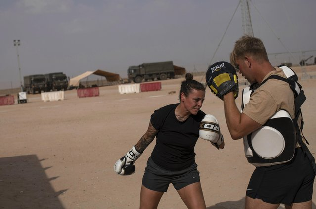 "Gunner, Danielle Bullock, 1st Regiment, Royal Horse Artillery takes part in boxing training at the Convoy Re-supply Centre during exercise ""Saif Sareea 3"" on October 25, 2018 in Oman. (Photo by Dan Kitwood/Getty Images)"
