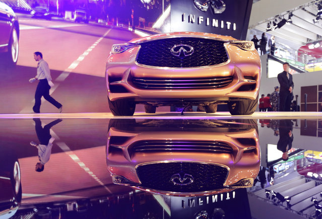 An Infiniti Q30 concept car is displayed at Auto China 2014 in Beijing April 20, 2014. Global automakers are scrambling to meet the demands of China's young urban professionals, who want a car that makes them stand out, yet don't always have the money to splurge on a top-end model. (Photo by Jason Lee/Reuters)