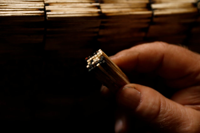 Janusz Urbanski holds matchsticks as he makes a new sculpture in his flat in Ruda Slaska, Poland May 4, 2016. (Photo by Kacper Pempel/Reuters)