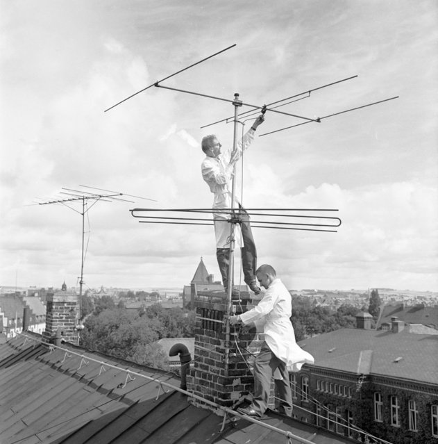 Early days of television in Sweden, 1953. The aerial is mounted by two men in white coats. From the Landskrona Museum Collection. (Photo by IBL Bildbyra/Heritage Images/Getty Images)