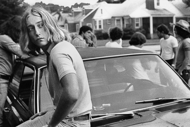 """Joseph Szabo was a frustrated high-school teacher in need of inspiration – so he started photographing his students, and captured all the angst and excitement of being caught between childhood and adulthood. Here: """"Tom on his Car"""", 1977. (Photo by Joseph Szabo/Courtesy of Michael Hoppen Gallery/The Guardian)"""