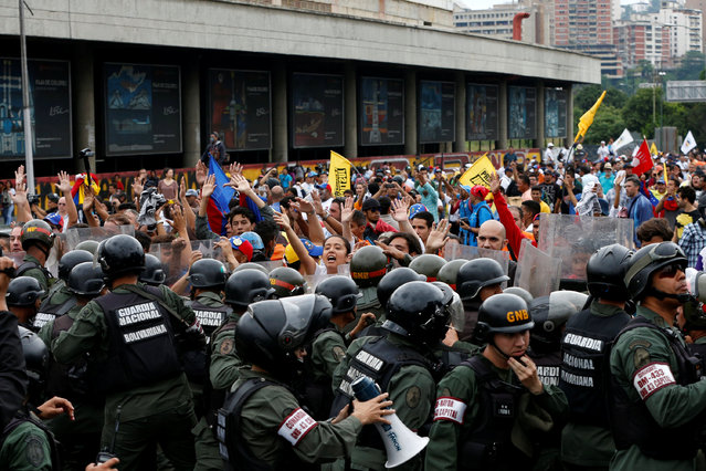 Opposition supporters clash with Venezuelan National Guards during a rally to demand a referendum to remove President Nicolas Maduro in Caracas, Venezuela, May 11, 2016. (Photo by Carlos Garcia Rawlins/Reuters)