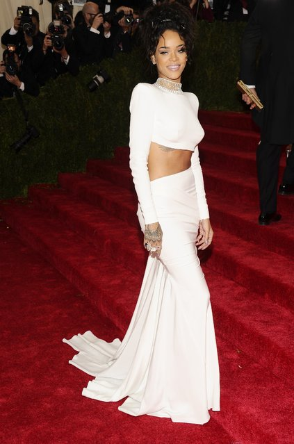 "Rihanna attends The Metropolitan Museum of Art's Costume Institute benefit gala celebrating ""Charles James: Beyond Fashion"" on Monday, May 5, 2014, in New York. (Photo by Charles Sykes/Invision/AP Photo)"