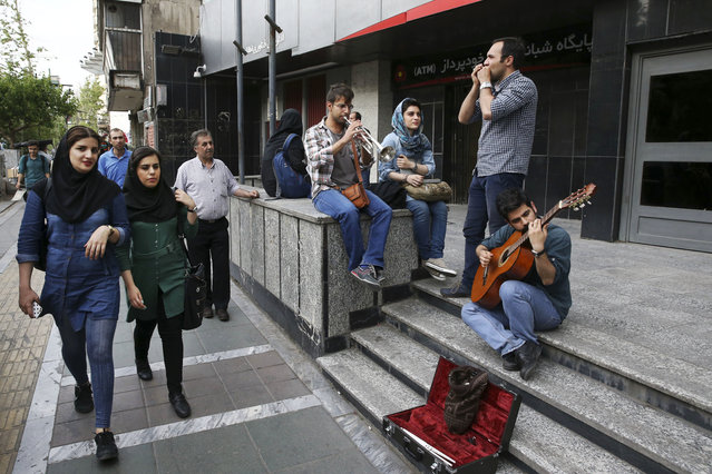 Iranian youngsters play music at a sidewalk in downtown Tehran, Iran, Tuesday, April 26, 2016. (Photo by Vahid Salemi/AP Photo)