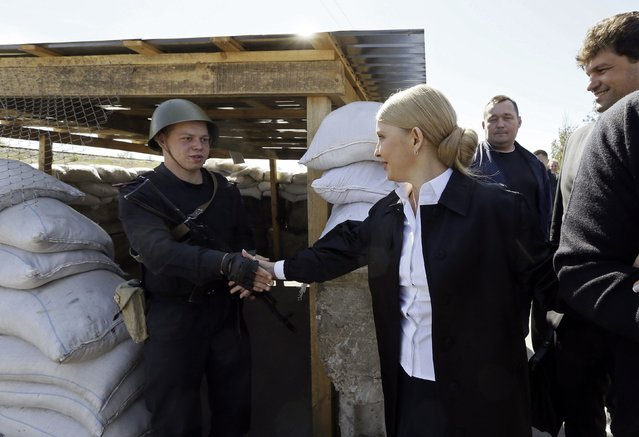 Ukrainian politician and presidential candidate Yulia Tymoshenko (2nd L) visits a checkpoint near Kakhovskaya Hydroelectric Power Plant in Kherson region, May 8, 2014. (Photo by Alexander Prokopenko/Reuters)