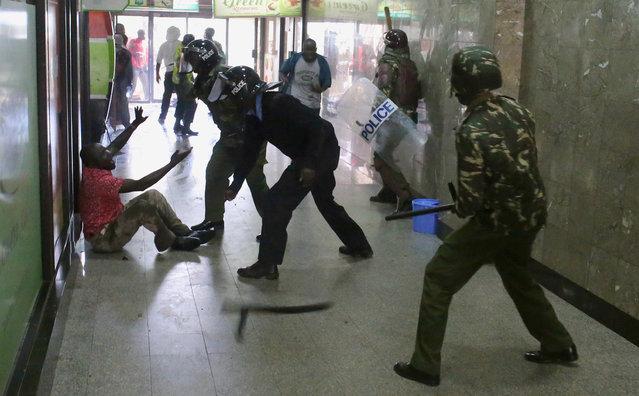 Kenya policemen beat a protester during clashes in Nairobi, Kenya May 16, 2016. (Photo by Goran Tomasevic/Reuters)