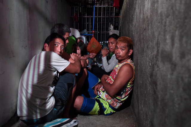 Alleged drug suspects detained at a small secret cell behind a wooden cabinet on April 27, 2017 in Manila, Philippines. The commission on Human Rights raided a Manila police station on Thursday to uncover a space of about 3 by 15 feet, where dozens of drug suspects, including 3 women, were detained for a week and allegedly brought out to be beaten or tortured, according to reports. The detainees alleges that they were kept inside the cramped cell without window, ventilation or lights for days, without filing any case against them, while waiting until a relative comes up with at least a thousand dollars paid to the police in exchange for their release. (Photo by Jes Aznar/Getty Images)