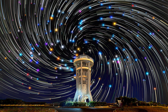 Star trails are pictured behind the Seletar Lookout Tower (or the rocket-shaped tower) in Singapore. These astonishing images of night sky are captured by Singapore based photographer Justin Ng. The pictures were taken between November 2013 to January 2014. It show's star trail caused by the earth's rotation and also can be achieved by zooming the DSLR lens inward or outward in small steps using a dedicated motorized zooming device. (Photo by  Justin Ng/Barcroft Media)
