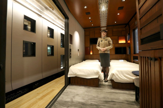 This picture taken on March 16, 2017 shows a crew member introducing a suite room of the Train Suite Shiki- Shima, operated by East Japan Railway, in Tokyo during a press preview. (Photo by AFP Photo/JIJI Press)