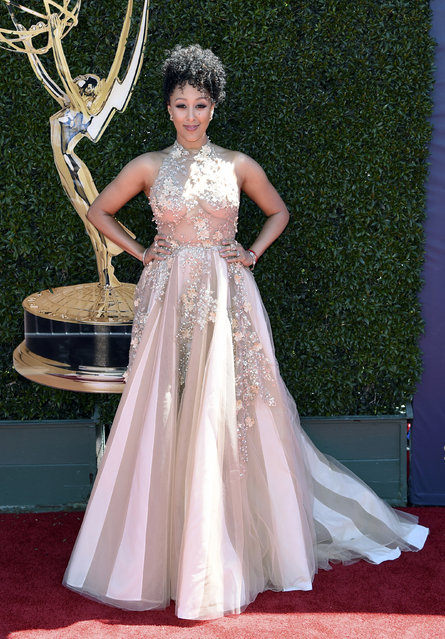 Tamera Mowry-Housley arrives at the 44th Annual Daytime Emmy Awards at the Pasadena Civic Center on Sunday, April 30, 2017, in Pasadena, Calif. (Photo by Richard Shotwell/Invision/AP Photo)
