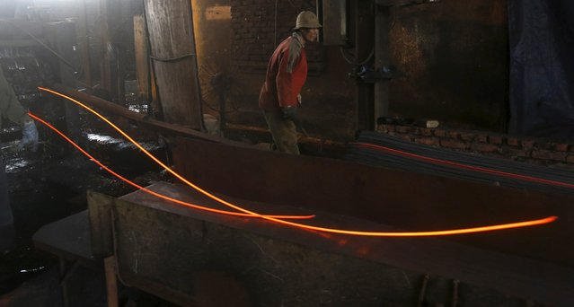 A man works at a steel mill in Bac Ninh province, outside Hanoi, Vietnam March 1, 2016. (Photo by Reuters/Kham)