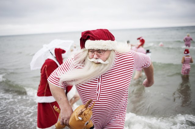 Participants of the World Congress of Santa Clauses 2015 take part in the annual swim at Bellevue beach, north of Copenhagen, Denmark, July 21, 2015. (Photo by Erik Refner/Reuters/Scanpix Denmark)