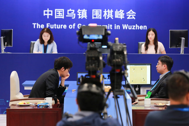 Chinese Go player Ke Jie reacts during his second match against Google's artificial intelligence program AlphaGo at the Future of Go Summit in Wuzhen, Zhejiang province, China May 25, 2017. (Photo by Reuters/Stringer)