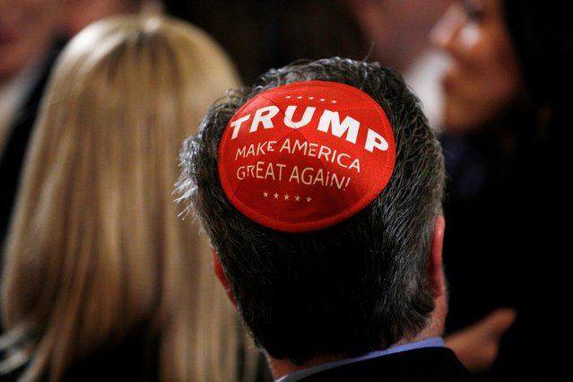 """A participant wears a Trump """"Make America Great Again"""" yarmulke as they attend a White House Hanukkah reception where U.S. President Donald Trump signed an executive order on anti-semitism in the East Room of the White House in Washington, U.S., December 11, 2019. (Photo by Tom Brenner/Reuters)"""