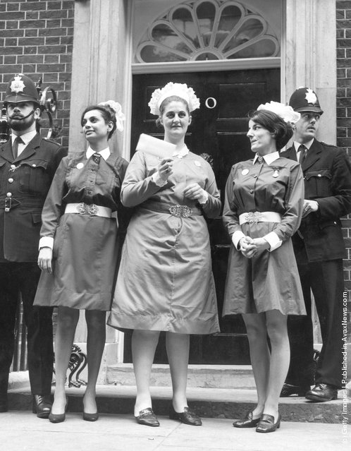 After taking part in a nurses' protest march from Speakers' Corner to Downing Street, Mary Chundee, Pat Veal (centre) and Tina Stone (right) prepare to hand in a petition to the Prime Minister, protesting about the pay and conditions of nurses working in Britain, 15th August 1968