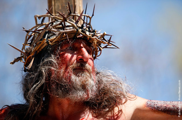 Joe Sanchez hangs on the cross during a re-enactment of the crucifixion of Jesus at Our Lady of Sorrows Church outside El Santuario de Chimayo in Chimayo, New Mexico, on April 22, 2011
