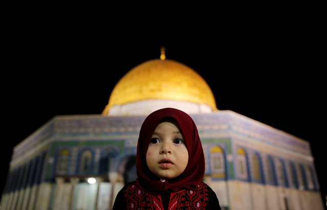 A Palestinian girl prays in front of the Dome of the Rock, at the compound known to Muslims as Noble Sanctuary and to Jews as The Temple Mount, in Jerusalem's Old City during the holy month of Ramadan June 7, 2016. (Photo by Ammar Awad/Reuters)