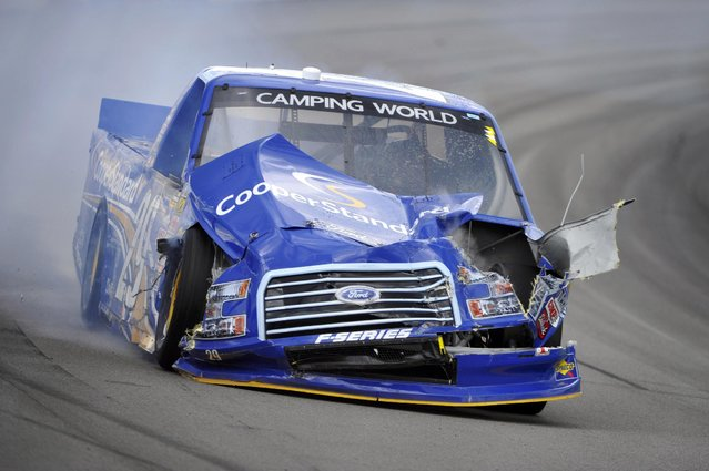 Brad Keselowski drives through Turn 3 after a wreck during the NASCAR truck series Pocono Mountains 150 auto race, Saturday, August 1, 2015, in Long Pond, Pa. (Photo by Derik Hamilton/AP Photo)
