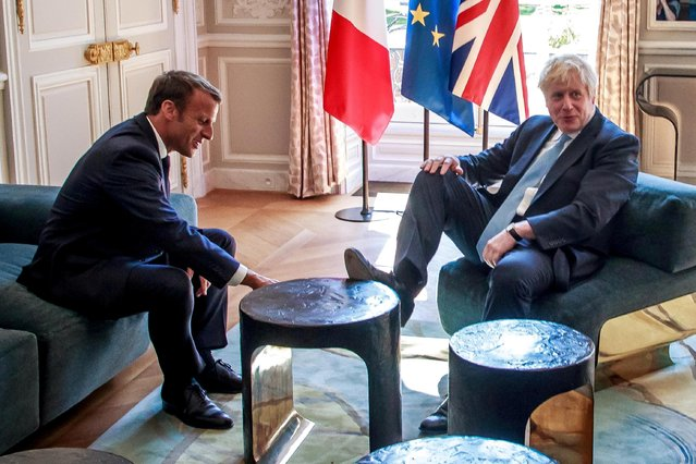French President Emmanuel Macron and British Prime Minister Boris Johnson speak during a meeting at the Elysee Palace in Paris, France, August 22, 2019. (Photo by Christophe Petit Tesson/Pool via Reuters)