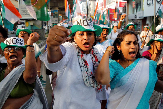 Supporters of India's main opposition Congress party shout slogans during a protest rally against a new citizenship law, in Kochi, India, January 10, 2020. (Photo by Sivaram V/Reuters)