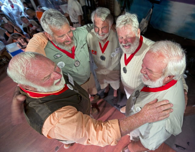 """In this Saturday, July 19, 2014, photo provided by the Florida Keys News Bureau, finalists in the 2014 """"Papa"""" Hemingway Look-Alike Contest congratulate each other just before the winner is announced at Sloppy Joe's Bar in Key West, Fla. (Photo by Andy Newman/AP Photo/Florida Keys News Bureau)"""