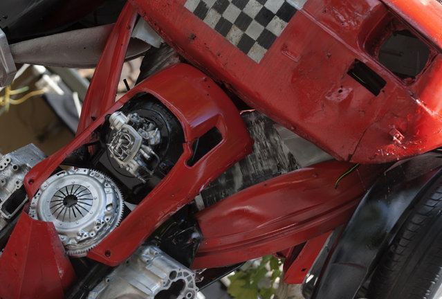 "A detail of a ""Muscle"" Transformer-inspired sculpture constructed from scrap metal is pictured in Podgorica, July 23, 2014. Danilo Baletic, 22, makes sculptures of his childhood cartoon heroes ""Transformers"" from scrap metal. In the last two years, he has made seven ""Transformers"" that are placed on the streets of Montenegro's capital Podgorica as part of an exhibition called ""Transformers defending Podgorica"". (Photo by Stevo Vasiljevic/Reuters)"