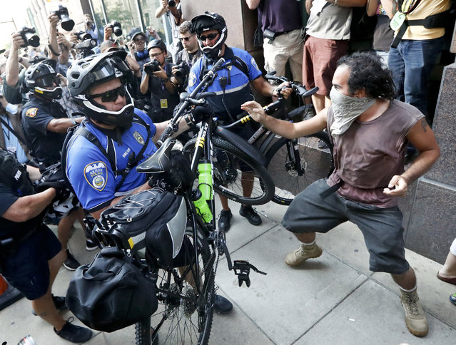 Protesters clash with police on Tuesday, July 19, 2016, in Cleveland, during the second day of the Republican convention. (Photo by John Minchillo/AP Photo)