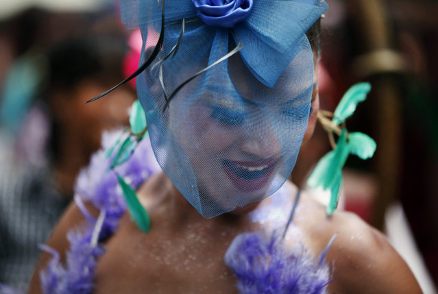 A participant dances in a gay rally in Kathmandu, Nepal, Sunday, August 30, 2015. Hundreds of lesbians, gays, bisexuals and transvestites paraded through Nepal's capital Sunday to demand that rights for sexual minorities be included in the country's new constitution that is being finalized. (Photo by Niranjan Shrestha/AP Photo)