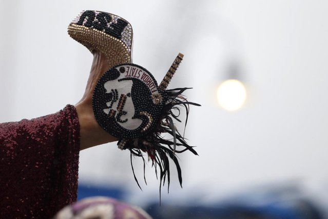 Miss Florida Victoria Cowen displays her shoe during the Miss America Shoe Parade at the Atlantic City boardwalk, Saturday, September 13, 2014, in Atlantic City, N.J. (Photo by Julio Cortez/AP Photo)